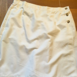 White skort with buttons on side